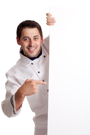 Chef cook showing at blank board. Isolated over white.