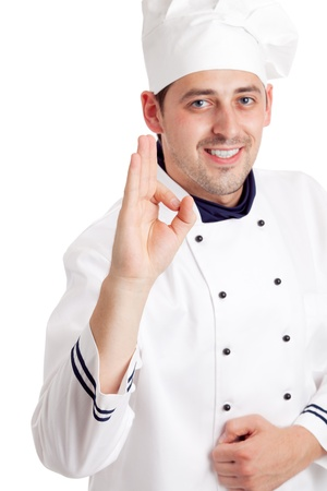 Chef giving the ok sign. Focused on hand. Isolated over white photo