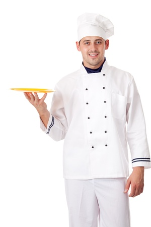 Chef holding plate with something. Isolated over white. photo