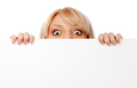 peek: Beautiful woman looking surprised and scared. Isolated over white. Stock Photo