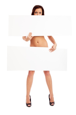 Sexy brunette with placard. Isolated over white. photo