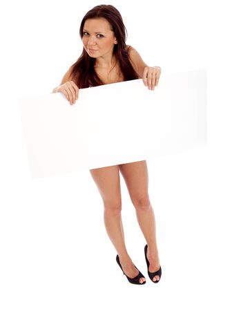 Sexy brunette with placard. Isolated over white.
