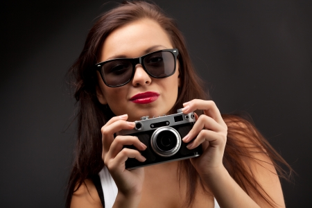 photographing: Woman with camera Stock Photo