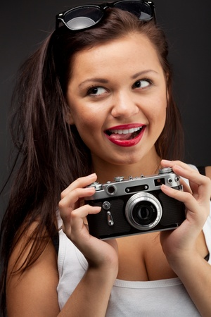 Woman with camera Stock Photo - 11150303