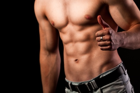 Muscular man with ok sign Stock Photo - 11150122