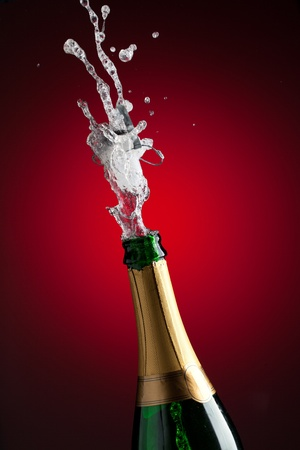 popping the cork: Openning champagne bottle Stock Photo