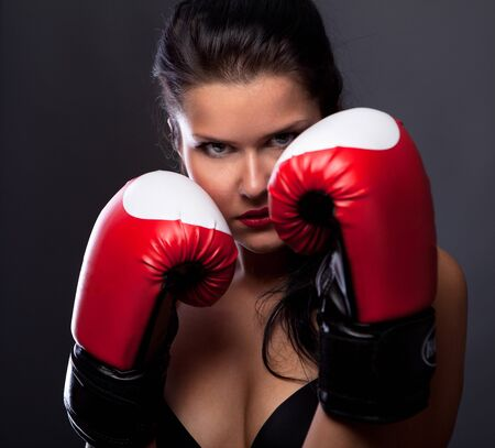 Woman with boxing gloves photo