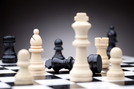 Chess pieces. Focused on black king photo