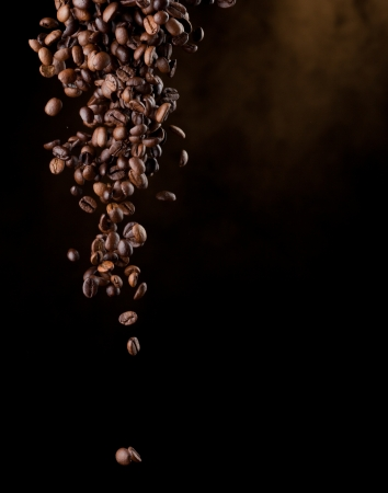 coffe beans: Flying coffee beans over dark