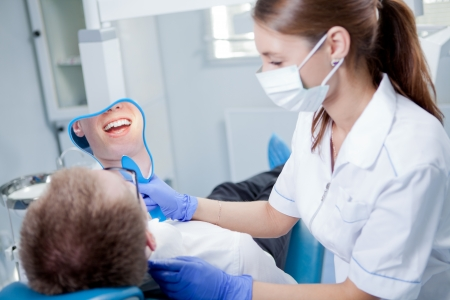 white glove test: A young female dentist working in her office  Stock Photo