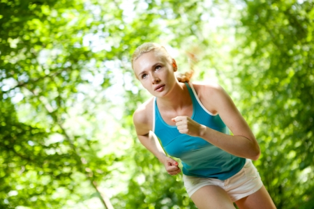 Woman Running Outdoors in Forest Banco de Imagens