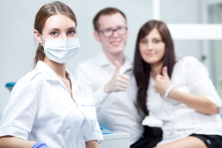 Dentist and young couple photo