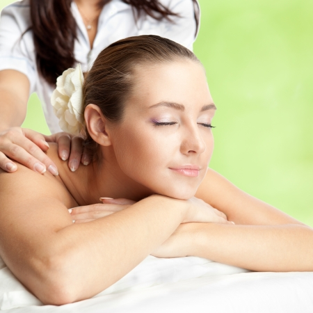 Beautiful woman at massage procedure