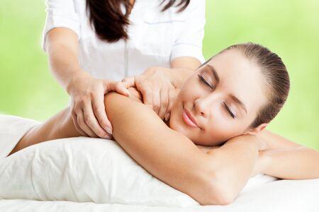 woman back of head: Beautiful woman at massage procedure