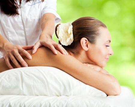 Beautiful woman at massage procedure photo