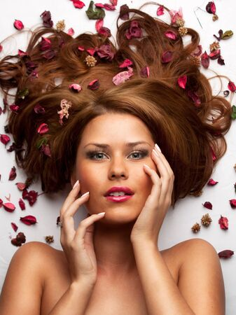 beautiful young woman with flowing hair and flowers photo