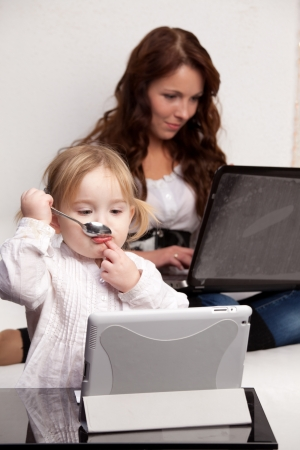 Mother and baby with laptop photo