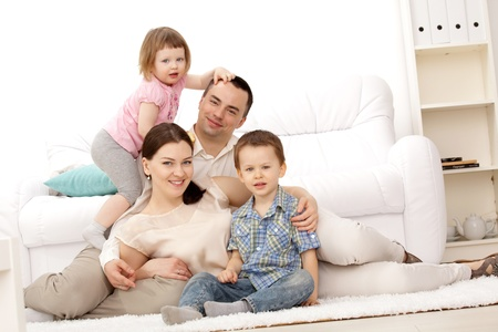 Family lying on a carpet in their living room Banque d'images