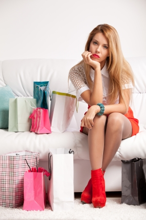 Tired woman returning after shopping photo