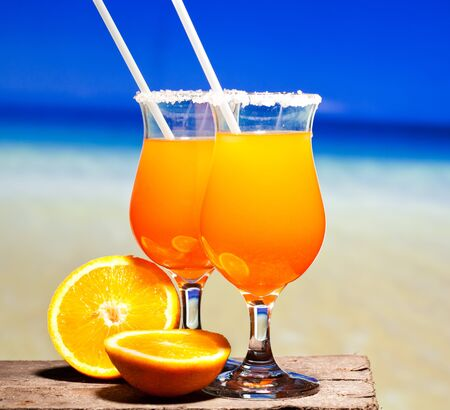pool bars: Tequila Sunrise Cocktail on wooden planks Stock Photo