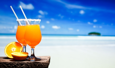 pool bar: Tequila Sunrise Cocktail on wooden planks Stock Photo