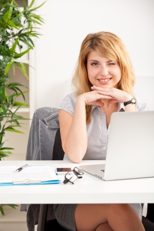 teleworking: woman at office