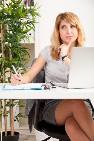 Portrait of woman working photo