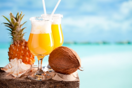 Pina colada drink on blue beach background