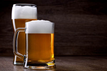 wino: Two glass beer on wooden table Stock Photo