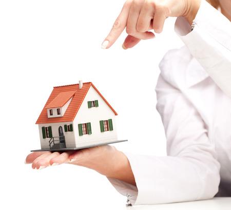 hand holding house isolated on white background photo