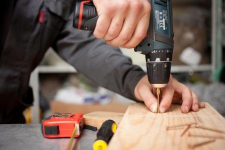 Man with screwdriver. Clouseup concept