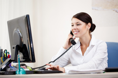 rolodex: Businesswoman talking by phone