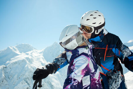 30 35 years: Young couple kissing in winter vacation