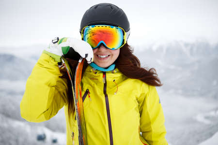 accomplices: Closeup of smiling woman skier