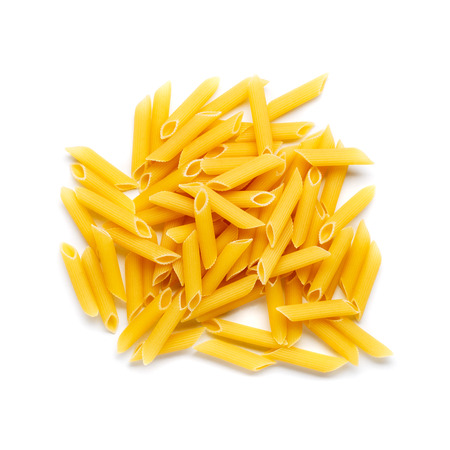 Raw italian penne rigate pasta isolated on white background