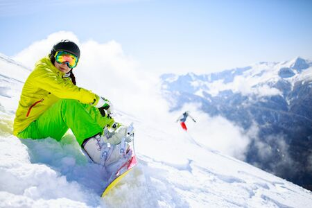 skying: Snowboarder sitting