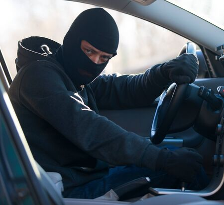 looting: Car thief Stock Photo