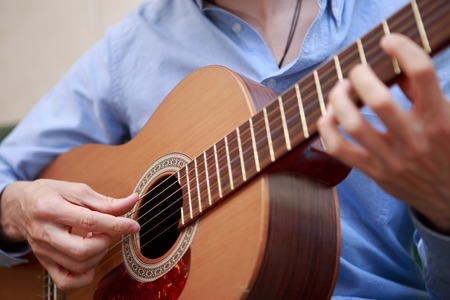 Man playing classic, acoustic guitar Stock Photo