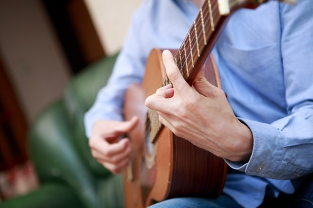fingerboard: Man playing classic, acoustic guitar Stock Photo