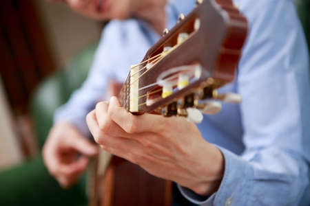 hand jamming: Young musician playing at acoustic guitar