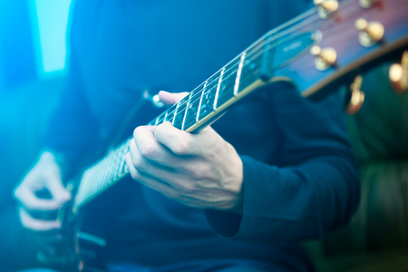 lonely man: Electric guitar player