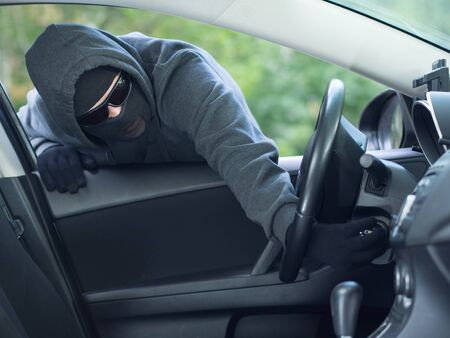 larceny: Burglar wearing mask balaclava stealing car key