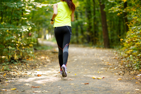 exercise weight: Runner feet running on road closeup on shoes in park Stock Photo