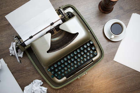 secretary phone: Old typewriter with white paper, ready for jounalist action
