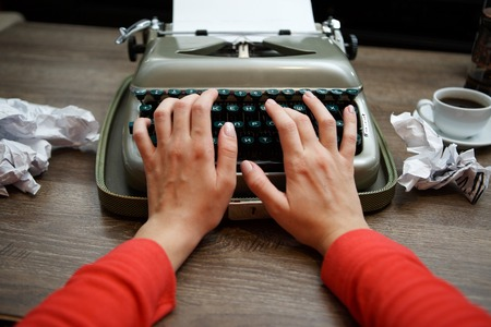 black secretary: Old typewriter, human hands, ready for jounalist action