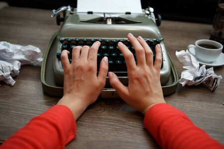 sentence typescript: Old typewriter, human hands, ready for jounalist action