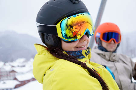 chairlift: Couple sitting on chairlift in mountain resorts.
