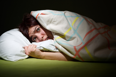 eyes opened: Young woman in bed with eyes opened suffering insomnia. Sleeping concept and nightmare issues Stock Photo