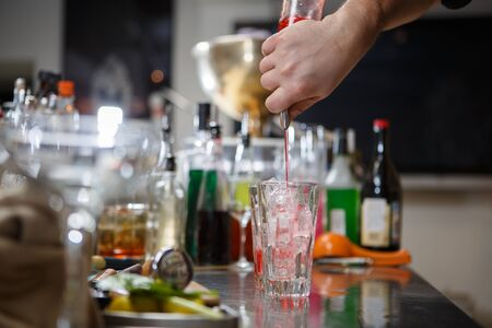 bar counter: Bartender coocks cocktail behind a bar counter Stock Photo