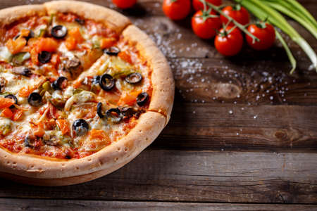 vegeterian: Vegeterian pizza with mushrooms and olives on wooden old table and fresh tomatos, green onion and chilli pepper on background